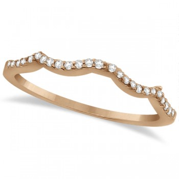 Contour Diamond Accented Wedding Band 14K Rose Gold (0.13ct) This lovely women's contour diamond wedding band contains 26 individually set near colorless diamonds.Set in 14K rose gold (pink gold), this contour band is part of a matched bridal set that includes an open twist diamond accented infinity engagement ring with a solitaire center for the diamond of your choice. Give her the wedding band she's been dreaming of and say 'I Do' in style.This contour diamond band wedding ring is made in the USA, like all of our other fine jewelry items.