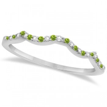 Diamond & Peridot Contour Wedding Band 14K White Gold 0.24ct Like icing on a cake, this diamond and peridot contour wedding band is the finishing touch to its companion infinity engagement ring.Artistically created from 14k white gold, this breathtaking wedding band is ablaze with 26 pave set, conflict free, diamonds and genuine green peridot gemstones.