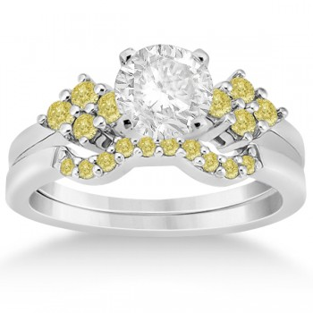 Yellow Diamond Engagement Ring & Wedding Band 18k White Gold (0.34ct) Show your eternal love for her with this fancy colored diamond cluster engagement ring with matching contour style wedding band bridal set.Eight yellow diamonds are pave set in a cluster style on each side of the center stone on an 18k white gold setting. Ten beautiful yellow diamonds are pave set on the matching contour wedding band.Each diamond is of VS2-SI1 clarity. Create your own engagement ring by choosing a center stone from our large selection of non-conflict diamonds.This 0.34ct 18k white gold modern floral engagement ring and contour wedding band bridal set is also available in other metals.