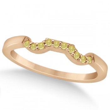 Pave Set Yellow Diamond Contour Wedding Band 14k Rose Gold (0.10ct) Adorn her finger with this pave set yellow diamond contour style wedding band, set in 14k rose gold (pink gold). The wedding band features ten fancy colored diamonds of VS2-SI1 clarity in a pave setting along the curve shaped wedding band.The yellow diamonds total to a 0.10 carat weight.Match this wedding band with our designer yellow diamond floral engagement ring, which is sold separately.