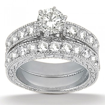 Antique Diamond Engagement Ring & Wedding Band 18k White Gold (1.70ct) A total of 23 large brilliant-cut round sparkling diamonds are beautifully set in a pave setting in this vintage style bridal set. The engagement ring setting showcases a total of 1.00ct of diamonds and the wedding band showcases  a total of 0.70ct.  The antique scroll work and the milgrain edges add the ultimate designer's touch to these rings.  Choose your own center stone to perfectly customize this matching engagement ring and matching wedding band.