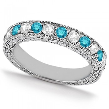 White & Blue Diamond Wedding Band Antique Style in Palladium 0.91ct This beautiful antique style diamond wedding band features .91tcw of white and blue diamonds set in palladium.Featuring seven brilliant cut round white diamonds and six fancy blue diamonds, this eternity style diamond band is a shining example of the love you share.The diamond ring features stunning milgrain edges and a beautiful filigree design detail that sparkles with sophistication.Not only can this fancy colored diamond band be worn alone, it's perfect for pairing with a diamond engagement ring, or as part of a bridal set.