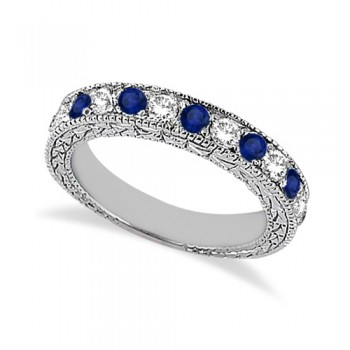 Antique Diamond & Blue Sapphire Wedding Ring 14kt White Gold (1.05ct) This vintage style semi eternity diamond and Blue Sapphire wedding ring features 7 brilliant cut VS2 G-H round diamonds alternating with 6 colored gemstones.The 14 karat White Gold Blue Sapphire wedding band has milgrain edges and a filigree design for the ultimate designer's touch.Wear it as a wedding band, as an anniversary ring, or as a right hand fashion ring.The diamond and blue sapphire ring measures 4.20mm tapering off to 3.95mm and is set in a pave setting.