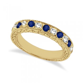 Antique Diamond & Blue Sapphire Wedding Ring 14kt Yellow Gold (1.05ct) This semi eternity vintage style Blue Sapphire and diamond wedding ring features 7 brilliant cut VS2 G-H round diamonds alternating with 6 colored gemstones.The 14 karat Yellow Gold Blue Sapphire wedding band has milgrain edges and a filigree design for the ultimate designer's touch.Wear it as a wedding band, as an anniversary ring, or as a right hand fashion ring.The heirloom diamond and sapphire ring measures 4.20mm tapering off to 3.95mm and is set in a pave setting.
