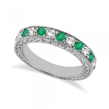 Antique Diamond & Emerald Wedding Ring 18kt White Gold (1.03ct) This vintage style diamond and Emerald wedding ring features 7 brilliant cut VS2 G-H round diamonds alternating with 6 colored gemstones.The 18kt White Gold semi eternity Emerald wedding band has milgrain edges and a filigree design for the ultimate designer's touch.Wear it as a wedding band, as an anniversary ring, or as a right hand fashion ring.The Emerald ring measures 4.20mm tapering off to 3.95mm and is set in a pave setting.