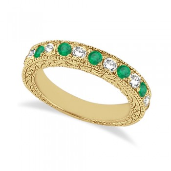 Antique Diamond & Emerald Wedding Ring 18kt Yellow Gold (1.03ct) This ancient style diamond and Emerald wedding ring features 7 brilliant cut VS2 G-H round diamonds alternating with 6 colored gemstones.The 18 karat Yellow Gold Emerald wedding band has milgrain edges and a filigree design for the ultimate designer's touch.Wear this semi eternity ring as a wedding band, as an anniversary ring, or as a right hand fashion ring.The heirloom Emerald ring measures 4.20mm tapering off to 3.95mm and is set in a pave setting.