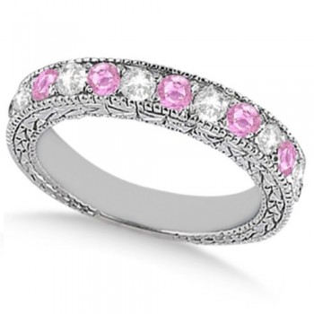Antique Pink Sapphire and Diamond Wedding Ring 18kt White Gold (1.05ct) This vintage style diamond and Pink Sapphire wedding ring features 7 brilliant cut VS2 G-H round diamonds alternating with 6 colored gemstones.The 18kt White Gold semi eternity Pink Sapphire wedding band has milgrain edges and a filigree design for the ultimate designer's touch.Wear it as a wedding band, as an anniversary ring, or as a right hand fashion ring.The heirloom pink sapphire ring measures 4.20mm tapering off to 3.95mm and is set in a pave setting.