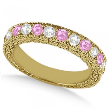 Antique Pink Sapphire and Diamond Wedding Ring 18kt Yellow Gold (1.05ct) This ancient style diamond and Pink Sapphire wedding ring features 7 brilliant cut VS2 G-H round diamonds alternating with 6 colored gemstones.The 18kt Yellow Gold Pink Sapphire wedding band has milgrain edges and a filigree design for the ultimate designer's touch.Wear this semi eternity ring as a wedding band, as an anniversary ring, or as a right hand fashion ring.The heirloom pink sapphire ring measures 4.20mm tapering off to 3.95mm and is set in a pave setting.