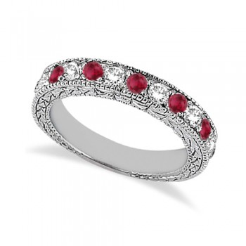 Antique Diamond & Ruby Wedding Ring 18kt White Gold (1.05ct) This vintage style diamond and ruby wedding ring features 7 brilliant cut VS2 G-H round diamonds alternating with 6 colored gemstones.The 18kt White Gold semi eternity Ruby ring has milgrain edges and a filigree design for the ultimate designer's touch.Wear it as a wedding band, as an anniversary ring, or as a right hand fashion ring.The heirloom ruby wedding band measures 4.20mm tapering off to 3.95mm and is set in a pave setting.
