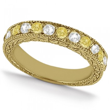 White & Yellow Diamond Wedding Band Antique Style 14K Yellow Gold 0.91ct This beautiful antique style diamond wedding band features .91tcw of white and fancy yellow diamonds set in 14K yellow gold.Featuring seven brilliant cut round white diamonds and six brilliant yellow diamonds, this eternity style diamond band is a shining example of the love you share.The diamond ring features stunning milgrain edges and a beautiful filigree design detail that sparkles with sophistication.  Not only can this colored diamond band be worn alone, it's perfect for pairing with a diamond engagement ring, or part of a bridal set.