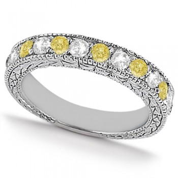 White & Yellow Diamond Wedding Band Antique Style in Palladium 0.91ct This beautiful antique style diamond wedding band features .91tcw of white and fancy yellow diamonds set in palladium.Featuring seven brilliant cut round white diamonds and six brilliant yellow diamonds, this eternity style diamond band is a shining example of the love you share.The diamond ring features stunning milgrain edges and a beautiful filigree design detail that sparkles with sophistication.  Not only can this colored diamond band be worn alone, it's perfect for pairing with a diamond engagement ring, or part of a bridal set.