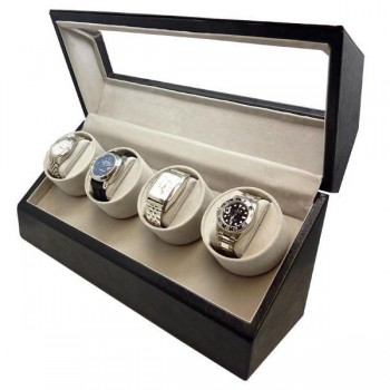 Quad Automatic Watch Winder in Black Leather Our Quad automatic watch winder is the perfect accessory for those with a large watch collection. Watch winders are essential to winding your watches and ensuring that they run smoothly and efficiently. This quad automatic watch winder has four individual winders, suiting your collection's needs.Crafted with a black leather exterior and a light grey velvet interior with a clear top display, this watch winder box looks as good as it works. Cushioned watch pillows ensure your timepiece's safe storage.This winder will allow you to control each winder separately; compatible with many popular brand watches and oversized watches.