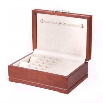 Solid American Cherry Hardwood Jewelry Chest w/Heritage Cherry Finish Protect your cherished jewelry in the sophistication jewel chest made by the American Chest Company. This wooden jewelry chest comes in an elegant heritage cherry finish.The jewelry chest features double swing out chain bars, two watch or bracelet pillows, a lift out tray with ring rolls and earring compartments and multiple compartments under the lift out tray.The jewelry chest measures 9 inches wide, 5 inches in height and 13 inches long.Keep your jewelry safe in style with the sophistication jewel chest.