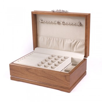 Solid American Cherry Hardwood Jewelry Chest w/Heritage Walnut Finish Keep your treasured jewelry protected in the sophistication jewel chest created by the American Chest Company. This wooden jewelry chest comes in a gorgeous heritage walnut finish.The jewelry chest features double swing out chain bars, two watch or bracelet pillows, a lift out tray with ring rolls and earring compartments and multiple compartments under the lift out tray.The jewelry chest measures 9 inches wide, 5 inches in height and 13 inches long.The sophistication jewel chest is truly beautiful and to be cherished for a lifetime.