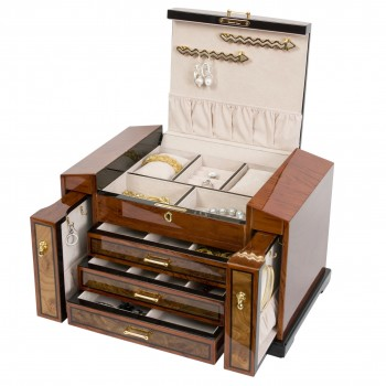Bubinga Jewelry Chest w Elm Burl Trim w 3 Drawers & 2 Watch Pillows This bubinga jewelry chest with elm burl trim is a creatively designed jewelry chest to maximize storage area.The jewelry chest features three pull out drawers, multiple compartments, necklace hooks to keep your necklaces from tangling, ring rolls, two watch pillows and a lockable top.This bubinga jewelry chest contains a chamois faux suede interior to ensure the protection of your jewelry.