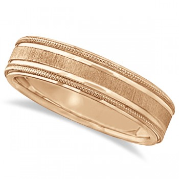 Carved Edged Milgrain Wedding Ring in 14k Rose Gold (5mm) A satin finished milgrain edge adds a hint of style to this otherwise traditional band. This carved wedding band features a satine center with satin finished edges adding a designer's touch to this unique ring. This band is comfort fit, which means it has rounded inside edges providing an ultimate comfort for him to enjoy. Crafted in 14k Rose Gold.Wear this as a right hand fashion ring or an anniversary ring.