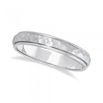 Satin Hammered Finished Carved Wedding Ring Band 14k White Gold (4mm) This modern carved design ring is crafted in 14kt white gold and is ideal for men or for women. The ring has a unique satin hammer finished inlay and a ridged edge design. This gents/ladies inlaid band is comfort-fit with rounded inside edges to provide a perfect fit for him or for her. Wear this contemporary dome style men's or women's ring as a wedding band, as an anniversary ring, or as a fancy right hand fashion ring. Available in other finishes, other widths, and other precious metal types.