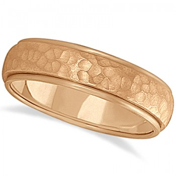 Mens Satin Hammer Finished Wedding Ring Wide Band 14k Rose Gold (6mm) This modern carved design ring is crafted in 14kt pink gold (rose gold) and is ideal for men. The unique ring has a satin hammer finished inlay and a ridged edge design. This inlaid band gentlemen's ring is comfort-fit with rounded inside edges to provide a perfect fit for him. Wear this contemporary dome style men's ring as a wedding band, as an anniversary ring, or as a fancy right hand fashion ring. Available in other finishes, other widths, and other precious metal types.