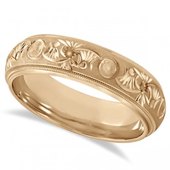 Hand Engraved Floral Wedding Ring in 18k Rose Gold (6mm) A modern ring is detailed with a lasting style in this carved wedding band. Beautifully crafted in 18k rose gold this hand engraved wedding ring is stunning. A glass bead finish center is bordered by high polished edges creating a radiant look for men, as well as for women. The inside of this wedding band is rounded for a comfort fit he can appreciate.Wear this unique band as a right hand fashion ring or as an anniversary ring.