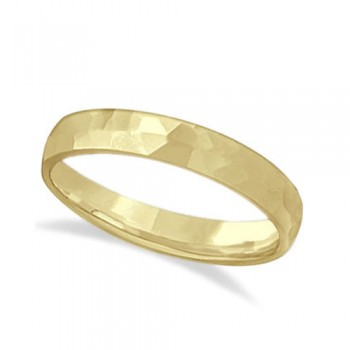 Carved Hammered Finish Wedding Ring Band 14k Yellow Gold (3mm) This unisex carved wedding ring is crafted in 14kt yellow gold and showcases a shiny hammer finished band. For men or for women that do not want to sacrifice style for comfort, this modern low dome styled band is comfort-fit. Rounded inside edges provide a perfect fit for him or for her. Wear this contemporary men's/women's carved ring as a wedding band, as an anniversary ring, or as a fancy right hand fashion ring. Available in other finishes, other widths, and other precious metal types.