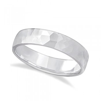 Men's Hammered Finished Carved Band Wedding Ring 18k White Gold (5mm) This contemporary men's designer ring is crafted in 18kt white gold and features a shiny hammer finished band. For men that do not want to sacrifice style for comfort, this low dome styled band is comfort-fit with rounded inside edges to provide a perfect fit for him. Wear this modern carved gentlemen's ring as a wedding band, as an anniversary ring, or as a fancy right hand fashion ring. Available in other finishes, other widths, and other precious metal types.
