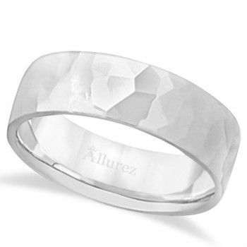 Men's Hammered Finished Carved Band Wedding Ring 18k White Gold (7mm) This contemporary men's designer ring is crafted in 18kt white gold and features a shiny hammer finished band. For men that do not want to sacrifice style for comfort, this low dome styled band is comfort-fit with rounded inside edges to provide a perfect fit for him. Wear this modern carved gentlemen's wide band ring as a wedding band, as an anniversary ring, or as a fancy right hand fashion ring. Available in other finishes, other widths, and other precious metal types.