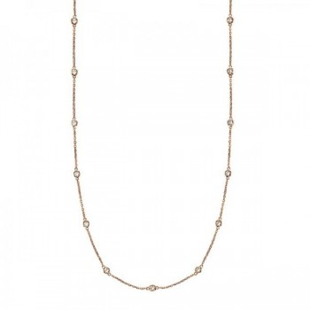 36 inch Long Diamond Station Necklace Strand 14k Rose Gold (0.66ct) Twenty eight round diamonds glisten in a bezel setting in this alluring 36 inch diamond layered necklace. The diamonds are about 1 1/4 inches apart from each other. A great accessory to sparkle up your day, this 36 diamond station necklace in 14k rose gold  is extremely trendy, classy, and fashionable. Wrap it around twice in layers or wear it as one long necklace. Available in other diamond carat weights, and other lengths. For more customization options, please call 1-800-554-3509 to speak to a Diamond and Jewelry Consultant.