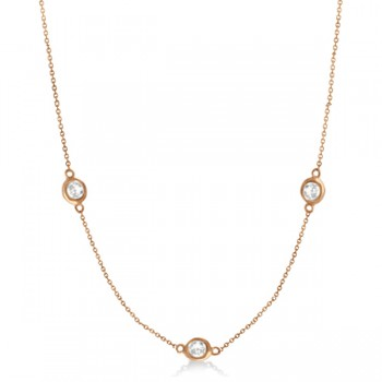 Diamond Station Three Stone Bezel-Set Necklace 14k Rose Gold (1.50ct) Set in a 14k rose gold (pink gold) bezel style setting, this diamonds by the yard necklace is equal parts unique and elegant. 3 brilliant-cut nearly colorless G-H color, and SI1-2 clarity round diamonds wrap half way around this station style necklace to keep all eyes on her.Available in other diamond carat weights, and in 16, 18, 20 and other lengths. If you would like this necklace in a different length please contact us.