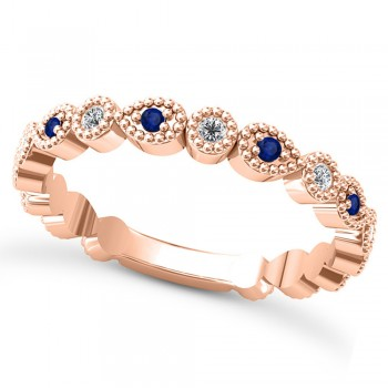 Alternating Diamond & Blue Sapphire Wedding Band 14k Rose Gold (0.21ct) This 14k rose gold diamond and blue sapphire wedding band is anything but ordinary.8 individual diamonds and 9 individual blue sapphires cover almost the entire band, and are each surrounded by milgrain edging, alternating between diamond round shapes and blue sapphire pear shapes.The sides and bottom of this ring are smooth, so it fits comfortably on your finger.The 0.08ct of bezel set diamonds are G-H color and SI1-SI2 clarity, and the 0.14ct of prong set blue sapphires are eye clean.This beautiful all around ring can be worn as a wedding band, as a stackable ring, or as a right hand fashion ring.