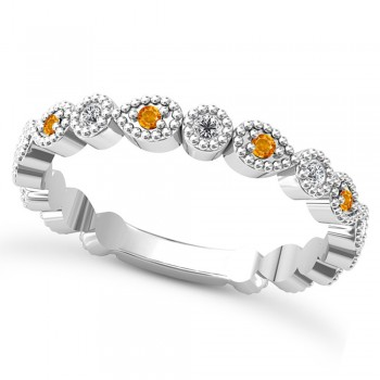 Alternating Diamond & Citrine Wedding Band Platinum (0.21ct) This platinum diamond and citrine wedding band is anything but ordinary.8 individual diamonds and 9 individual citrines cover almost the entire band, and are each surrounded by milgrain edging, alternating between diamond round shapes and citrine pear shapes.The sides and bottom of this ring are smooth, so it fits comfortably on your finger.The 0.08ct of bezel set diamonds are G-H color and SI1-SI2 clarity, and the 0.14ct of prong set citrines are eye clean.This beautiful all around ring can be worn as a wedding band, as a stackable ring, or as a right hand fashion ring.