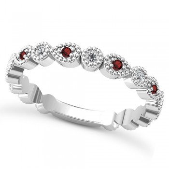 Alternating Diamond & Garnet Wedding Band Platinum (0.21ct) This platinum diamond and garnet wedding band is anything but ordinary.8 individual diamonds and 9 individual garnets cover almost the entire band, and are each surrounded by milgrain edging, alternating between diamond round shapes and garnet pear shapes.The sides and bottom of this ring are smooth, so it fits comfortably on your finger.The 0.08ct of bezel set diamonds are G-H color and SI1-SI2 clarity, and the 0.14ct of prong set garnets are eye clean.This beautiful all around ring can be worn as a wedding band, as a stackable ring, or as a right hand fashion ring.