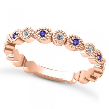 Alternating Diamond & Tanzanite Wedding Band 14k Rose Gold (0.21ct) This 14k rose gold diamond and tanzanite wedding band is anything but ordinary.8 individual diamonds and 9 individual tanzanites cover almost the entire band, and are each surrounded by milgrain edging, alternating between diamond round shapes and tanzanite pear shapes.The sides and bottom of this ring are smooth, so it fits comfortably on your finger.The 0.08ct of bezel set diamonds are G-H color and SI1-SI2 clarity, and the 0.14ct of prong set tanzanites are eye clean.This beautiful all around ring can be worn as a wedding band, as a stackable ring, or as a right hand fashion ring.