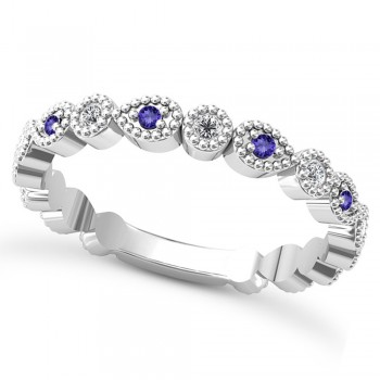 Alternating Diamond & Tanzanite Wedding Band Platinum (0.21ct) This platinum diamond and tanzanite wedding band is anything but ordinary.8 individual diamonds and 9 individual tanzanites cover almost the entire band, and are each surrounded by milgrain edging, alternating between diamond round shapes and tanzanite pear shapes.The sides and bottom of this ring are smooth, so it fits comfortably on your finger.The 0.08ct of bezel set diamonds are G-H color and SI1-SI2 clarity, and the 0.14ct of prong set tanzanites are eye clean.This beautiful all around ring can be worn as a wedding band, as a stackable ring, or as a right hand fashion ring.