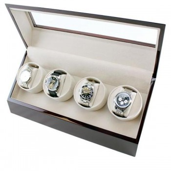 Quad Automatic Watch Winder Cherrywood Finish A watch winder is essential to preserve smooth functioning of dormant automatic watches. They mimicking the movements of your wrist to keep it winded and ready to wear all the time. If you have a large watch collection, chances are some of your watches are not winded correctly. With this quad automatic watch winder that has four individual winders, you can rest assured that all your watches will be properly winded and stored correctly.With a cherry wood finish, beige velvet interior, and clear top this watch winding box is the perfect way to store and display your self-winding watches. Cushioned pillows kept your watches protected.Will wind many different watches from various brands and oversized ones.
